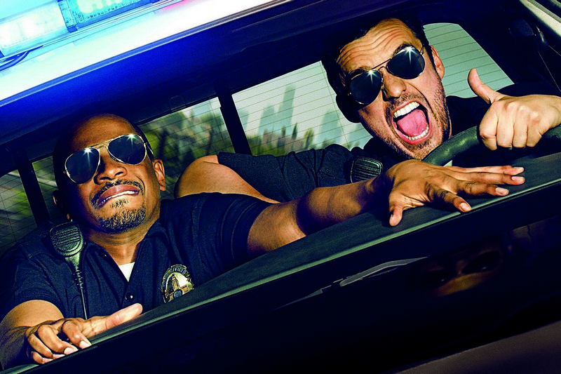 LET'S BE COPS-  Justin (Damon Wayans, Jr.)  Ryan (Jake Johnson, right) think pretending to be cops is a laughing matter — but that's about to change.  TM and © 2014 Twentieth Century Fox Film Corporation.