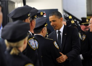 "US President Barack Obama greets police officers at the First Precinct police station in lower Manhattan in New York on May 5, 2011. Obama will participate in a wreath laying ceremony at the 9/11 Memorial. Obama was Thursday braced for a ""bittersweet"" visit to Ground Zero after the killing of Osama bin Laden, but felt it was important to go to offer ""closure"" to Americans. AFP PHOTO/Jewel Samad (Photo credit should read JEWEL SAMAD/AFP/Getty Images)"